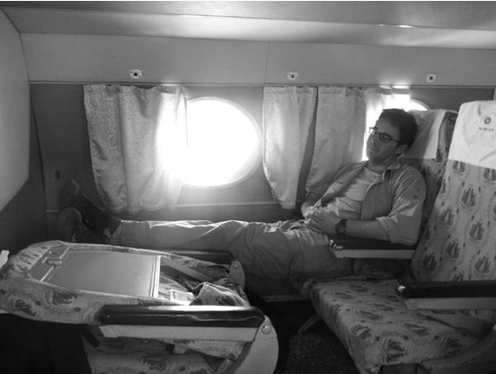 jonathan lewis getting some rest on a flight between filming in the
